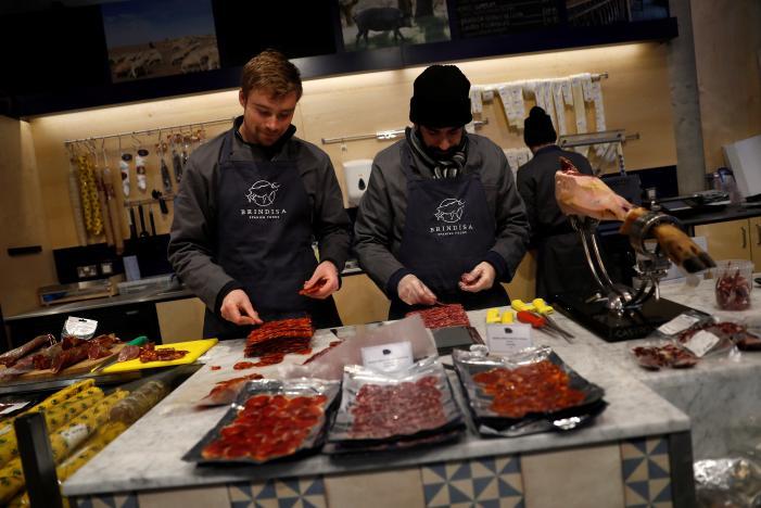 Members of staff work in a Brindisa shop, a Spanish fine food business, at Borough Market in London, Britain, November 22, 2016.  REUTERS/Stefan Wermuth